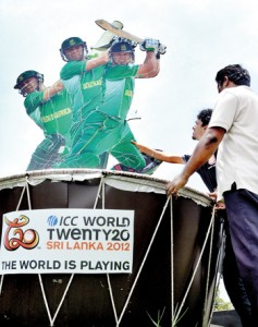 Workers putting the final touches to the ICC World T-20 cut-outs that have sprung up all over the island. Pic by Amila Gamage