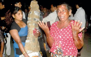 Shattered dreams: One of the pilgrims breaks down on their arrival at the BIA on Wednesday night. N. Kumarasinghe