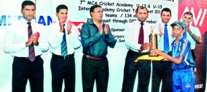 Under 13 winning captain, Harshan Yogendra of MCA Cricket Academy 'Blues' receiving the trophy from Sisira Pathmadeva,