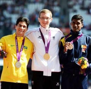 Pradep Sanjaya (Right) with God Medallist Gunther Matzinger of Austria (Center)  and Yohanson Nascimento of Brazil (Left).