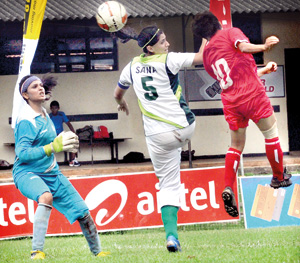 Female footballers of Nepal were on the rampage when they thrashed Pakistan by 8-0. - Pic by Amila Gamage.