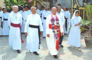 The Archbishop of Colombo, Malcolm Cardinal Ranjith being conducted into the School premises by the College Director, Reverend Doctor Leslie Fernando. The Principal Sister Mercy Fernando is seen in the background.