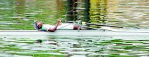 After a tiring race, an AIS oarsman