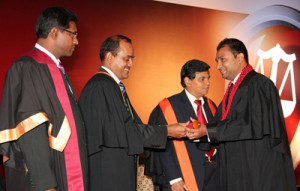 CA Sri Lanka President Mr. Sujeewa Rajapakse hands over the Associate Certificate to a new CA Sri Lanka member at the 2012 convocation in the presence of Secretary to the Ministry of Co-operatives and Internal Trade Mr. G.K.D Amarawardena�and CA Sri Lanka Chief Executive officer Mr. Aruna Alwis.
