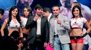 Manny Pacquiao of the Philippines (L) and Juan Manuel Marquez of Mexico pose ahead of their bout in Las Vegas at Mexico City Arena in Mexico City. Reuters.