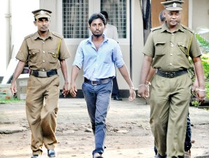 As the university and education crisis intensifies, police arrested Inter University Students' Federation (IUSF) Convenor Sanjeewa Bandara who had been in the forefront of protest campaigns. The student leader was travelling in a bus when he was dragged out by three police officers in civvies and hauled into a waiting police van. The handcuffed Bandara was later produced in court and remanded for allegedly violating court orders regarding the satyagraha and vandalism. Pic by Indika Handuwela.