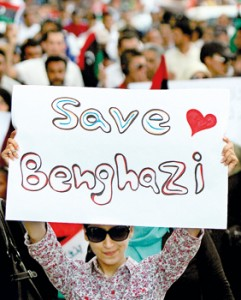 A Libyan demonstrator holds a sign as thousands of people march in Benghazi during a protest against militias on Friday. AFP