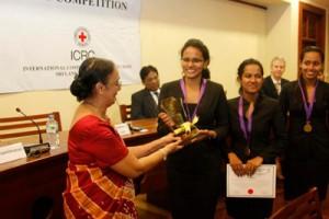 The Vice Chancellor of the University of Colombo Professor Kshanika Hirimburegama giving away the Championship trophy to APIIT National Champions.— at�Senate Room, College House, University of Colombo.