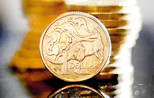 Australian one dollar coins are displayed in this photo (Reuters)