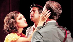 I'd be surprisingly good for you: Melanie Bibile as Evita with Mario de Soyza as Peron and  Rehan Almeida as Che in the background.  Pic by Indika Handuwala