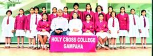 The champion Holy Cross team: Seated (from left): Shehani Modaragama, Mahesha Ekanayake (Coach), Rev Sister Mary Deepani (Principal), Ashini Navoda (Captain), Petronilda Biyanwala (Vice Captain). Standing (from left): Poornavi Harshika, Salini Dias, Dilushi Hasinika, Hashini Chamodya, Januli Thinara, Dakshina Nishani, Tharushi Ishara, Anuki Viveka, Hansani Jayasinghe, Manesha Dilakshi, Dinithi Dias, Oshadee Karunaratne, Oavani Navodya, Thehani Sanjula, Nethni Himasha.