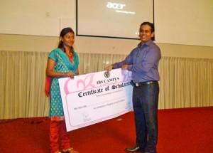 Mr. Lakmal Perera, awarding the scholarship for a participant