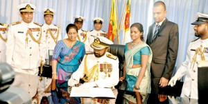 The new Navy Commander assuming duties at an auspicious time at Navy Headquarters on Thursday in the presence of family members and Navy officers. Pic by Indika Handuwala