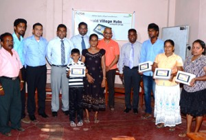 The picture shows the initial four families selected from Bathiyagama, Kantalai  who were educated on the Android Village Hub initiative and amongst them were Etisalat Lanka - Head of Prepaid and Brand Marketing, Shameel Bishri, Head of Human Resources, Srinath Fonseka, Head of Corporate Communications, Pradeep Carvalho, Regional Business Manager, Suresh Mohamed and from Sarvodaya Fusion - Managing Director, Dr. Harsha Liyanage, Coordinator Mobile4D Projects, Udara Dharmasena and Coordinator - Sarvodaya Resource Centre Kantalai, Sunil Wickramarachchi.