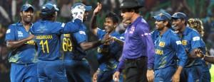 Sri Lankans celebrate Gayle's wicket.