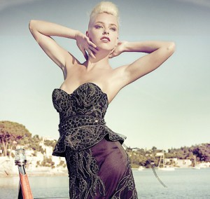 Posing on the back of a luxurious yacht, a model shows off the dress, which was created by fashion designer Debbie Wingham