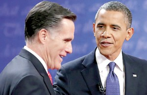 President Barack Obama (R) and his Republican contender Mitt Romney speak after the Presidential Debate at the University of Denver on October 3. AFP