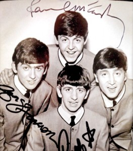 Phenomenon: An autographed photo of The Beatles is displayed at an exhibition(Reuters)