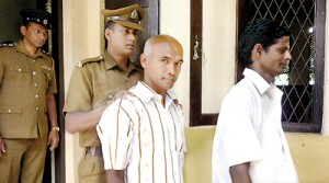 The suspects in the killing of the Premawathie and Pushpa brought to courts: Namal (top) Siripala (middle) and Mithila and Sisira