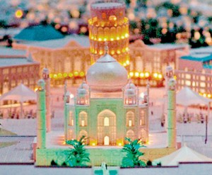 In miniature: A model shows the Taj Arabia complex with the Leaning Tower of Pisa behind