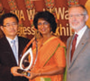 Ms. Athukorala receiving the award from IWA World Water Congress President Prof. Changwon Kim, with IWA President Dr. Glen Daigger on her left.