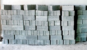 Concrete blocks (above) and bags of cement (below): At a high price