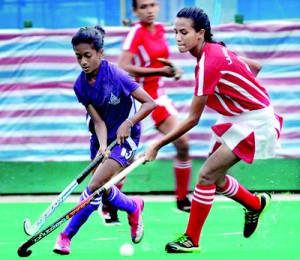 A tussle for the ball and control of the game as the game grew hot.  - Pic Amila Gamage