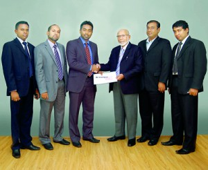 Seen above are (from left) - S. Gnanam, Head of Sales and Marketing of Tech Pacific Lanka (Pvt) Ltd; Hafez Wahid, Managing Director of Tech Pacific Lanka (Pvt) Ltd; Yusuf Shiraz, Sri Lanka Country Manager for Lenovo; M.D.H. Wahid, Chairman of Tech Pacific Lanka (Pvt) Ltd); and two other team members.