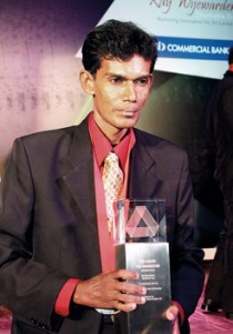 A proud moment: Mr. Karunatilake with his trophy. Pic by Indika Handuwala