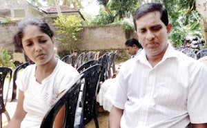 The grieving parents of little Kaveesha. Pix by K.D. Sugathapala