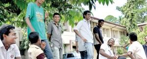 Back to university after three months: Kelaniya students share a light moment. Pix by Mangala Weerasekera