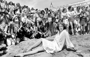 """A file picture taken on May 13, 1977 shows Dutch actress, model and singer Sylvia Kristel, posing as a """"starlet"""" on the Carlton Hotel beach in front of press photographers and fans, during Cannes Film Festival (AFP)"""