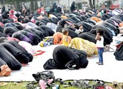 Mothers pray, children play