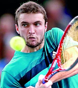 Simon survives, Tsonga upset at Paris Masters