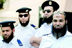 Bearded policemen take part in a protest in Cairo (REUTERS)