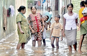 Scenes of flooding and devastation pour in from across the country. More than 15,000 peope have moved to temporary shelters. Photos: Indika Handuwala and Mangala Weerasekera