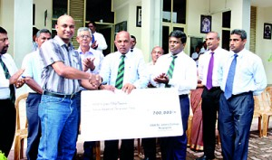 In the photograph the OBA , President  Chandana Perera accepts the cheque from Srinath Karunarathne , Secretary - OBA of St. John's College, Nugegoda branch in Australia. Also in the picture are Major D A D Wanaguru  ( Principal, of St John's College, Nugegoda),Daya Wickkramarathne ( Vice Patron - OBA), Ajith Mahendra ( Immediate Past President - OBA), Anoj Thillakarathne ( Vice President - OBA), J M Mirshan ( Executive Committee Member of the OBA)