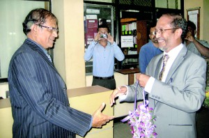 Author Harees (right) receiving chief guest and retired Chief Justice Asoka de Silva at the book launch at the auditorium of the Institute of Chartered Accountants.