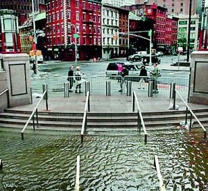 Water fills the Bowling Green subway station in Battery Park,New York (AFP)