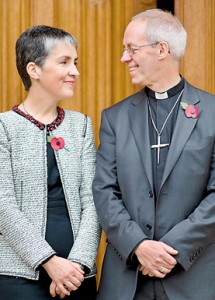 The new Archbishop of Canterbury Justin Welby (R) poses for pictures with his wife Caroline (AFP)