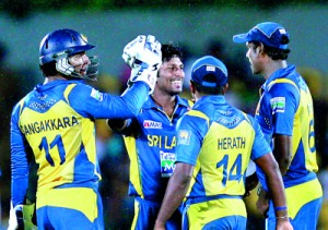 Jeewan Mendis, the man-of-the-match celebrates a wicket with his team mates.  - Pics by Shantha Ratnayake