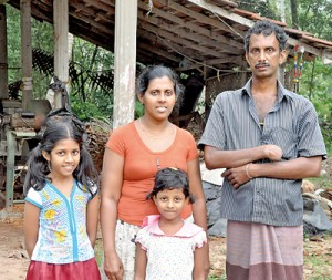 Blow after blow: Nandana with his wife and children. Pic by Ranjith Perera