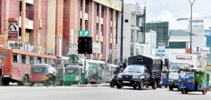 Chaos or order: No police officers at the busy Borella junction. Pix by Mangala Weerasekera