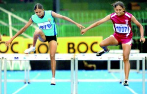 W.K.L.A. Nimali (in blue) of Sri Lanka Air Force went on to win the 400m Women's Hurdles final.