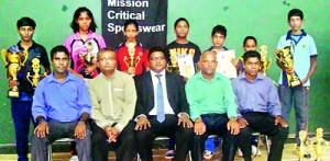 Seated (from left): D M G S Kumara (TT Coach - North Western Province), Dr. Thisara Perera (President - North Western Province TT Association), Isuru Jayawardane (Chief Guest), Chandana Perera (Chief Coordinating Officer - TTASL), Thushara Sampath (Tournament Secretary - TTASL) Back Row: Muthumalee Priyadharshani (U-15 Girls Singles Champion & U-18 Girls Singles Runner-up), Erandi Warusavithana (U-18 Girls Singles Champion), Hansani Piyumila (U-12 Girls Singles Champion), Lithmina Mahanama (U-12 Boys Singles Champion), Dewmith Weerasena (U-10 Boys Singles Champion), Dilmi Colombage (U-10 Girls Singles Champion), Udaya Ranasinghe (U-18 and U-15 Boys Singles Champion)