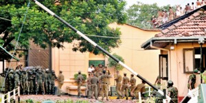 Commandos prepare for an assault while prison guards  try to talk prisoners down from the rooftop
