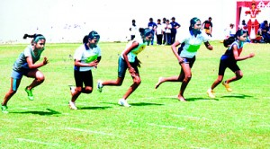 Start of the 100m under 13 girls. At extreme left is the winner Anishra Odayar.