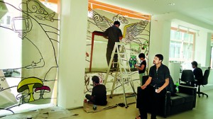 """Above- """"Agni Salaru"""" Interactive Multimedia Design exhibition held earlier this year, Mr. Nathan Ober oversees his students."""