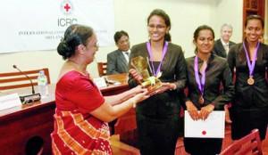 The Vice Chancellor of the University of Colombo Professor Kshanika Hirimburegama giving away the Championship trophy to APIIT National Champions.— at Senate Room, College House, University of Colombo.