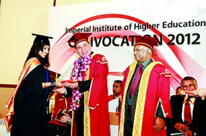 An MBA student being awarded the degree